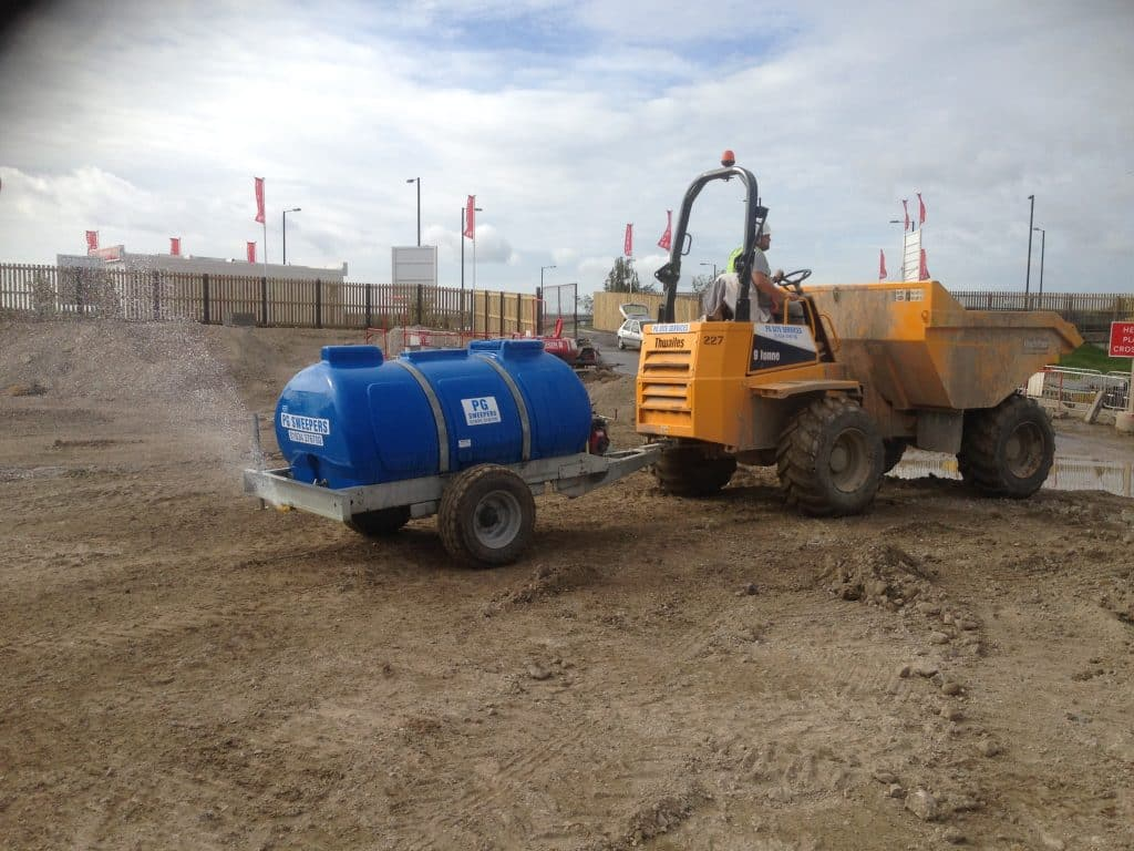 Dumper truck towed dust suppression system